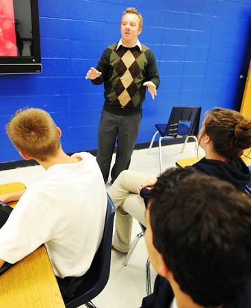 Instructor Patrick Bromley teaches a business class Wednesday, Oct. 16, 2013, at McAuley Catholic High School. Bromley was recently named Teacher of the Year from the diocese.<br /> Globe | T. Rob Brown