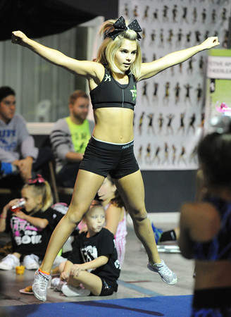 Jenee Cruise, a high school junior from Bakersfield, Calif., demonstrates cheerleading technique for a group of cheerleading students Saturday afternoon, Oct. 19, 2013, in Pittsburg, Kan. She is wearing a new type of sports bra.<br /> Globe   T. Rob Brown