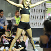 Jenee Cruise, a high school junior from Bakersfield, Calif., demonstrates cheerleading technique for a group of cheerleading students Saturday afternoon, Oct. 19, 2013, in Pittsburg, Kan. She is wearing a new type of sports bra.<br /> Globe | T. Rob Brown