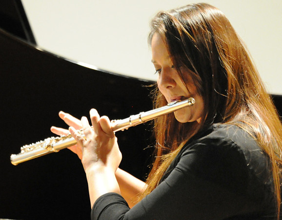 "Sara Cavener performs ""Concerto in A minor, movement II"" by Vivaldi on the flute during the Wednesday evening, Oct. 2, 2013, musical event for MSSU's Italy semester at Webster Hall's Corely Auditorium.<br /> Globe 