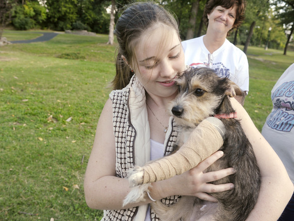 Globe/Roger Nomer<br /> Jeanette Jenkins, 16, holds her dog Houston during a visit to Leonard Park on Friday.