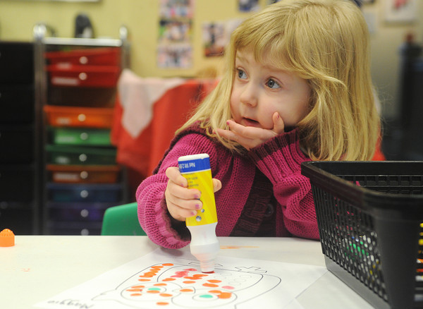 Globe/Roger Nomer<br /> Maggie Neuenschwander, 2, Joplin, listens intently to a story about owls during the Mommy and Me Art class at Spiva Center for the Arts on Tuesday morning.