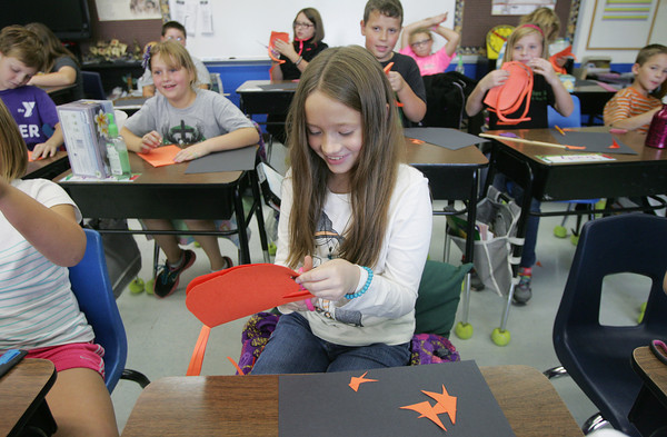 Globe/Roger Nomer<br /> Claudia Crowell, third grade, works on an art project at St. Mary's in Pierce City on Tuesday.