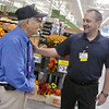 Globe/Roger Nomer<br /> Store Manager Greg Sanders talks with Keith Fiscus while working at the 15th Street Wal-Mart on Wednesday.