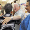 Globe/Roger Nomer<br /> Donald Patterson says goodbye to the staff at the community clinic after a day of volunteering on Tuesday.