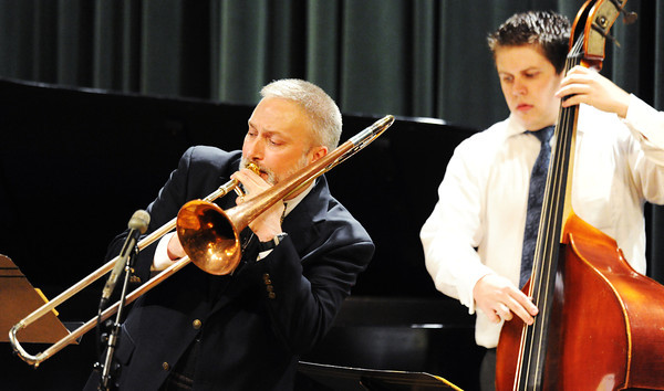 Dr. Phillip Wise (left) plays the trombone with the Joplin Jazz Collective as they perform in the style of Django Reinhardt, a famous Italian jazz guitarist, during the Wednesday evening, Oct. 2, 2013, musical event for MSSU's Italy semester at Webster Hall's Corely Auditorium.<br /> Globe | T. Rob Brown