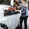 "Valerie Roberts of Joplin cleans her windshield as she fills the tank Thursday afternoon, Oct. 3, 2013, at the Fastrip on Duquesne Road, just north of Missouri Southern State University. ""We haven't seen it like that in a while,"" Roberts said of the drop below $3 a gallon.<br /> Globe 
