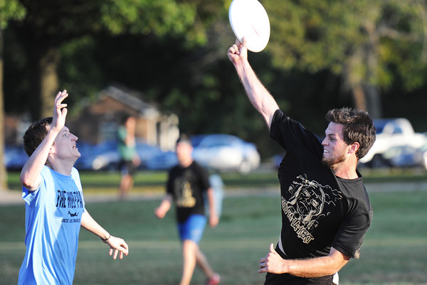 "Ozark Christian College students Micah Funderburgh (right), who plays for the Too-Ya-La-Kekt (or ""Thunder Arriving on the Plain"") team attempts to pass the disc to a teammate as opponent Ethan Humphrey of the Wolf-Pack plays defense during the semi-final intramural game of Ultimate Thursday evening, Oct. 3, 2013, at OCC. The Wolf-Pack ended up winning the game and will play in the championship at 6 p.m. Monday, Oct. 14. Ultimate is a game with similarities to soccer but uses a disc instead of a ball.<br /> Globe 