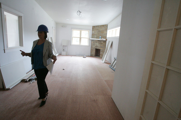 Globe/Roger Nomer<br /> During a tour on Monday, Liz Erickson, development coordinator at Children's Haven, shows the living room of the new facility being built next to the current Children's Haven building.