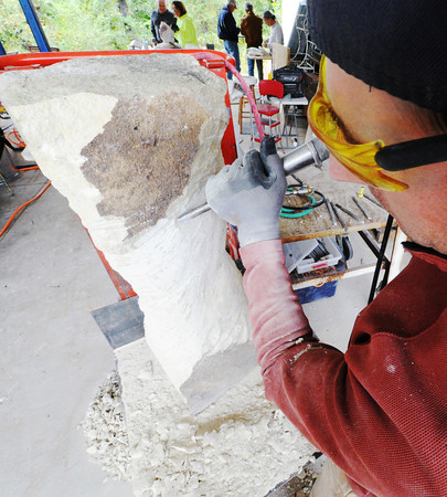Abraham Mohler, a St. Louis sculptor, chisels away stone as he creates a human figure Wednesday afternoon, Oct. 16, 2013, at the Joplin home of Jorge Leyva.<br /> Globe | T. Rob Brown