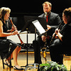 """A trio consisting of (from left) Felicia Eads, clarinet, Preston Besett, bass clarinet, and Addy Phillips, clarinet, performs """"La Danza"""" by Mangani during the Wednesday evening, Oct. 2, 2013, musical event for MSSU's Italy semester at Webster Hall's Corely Auditorium.<br /> Globe 