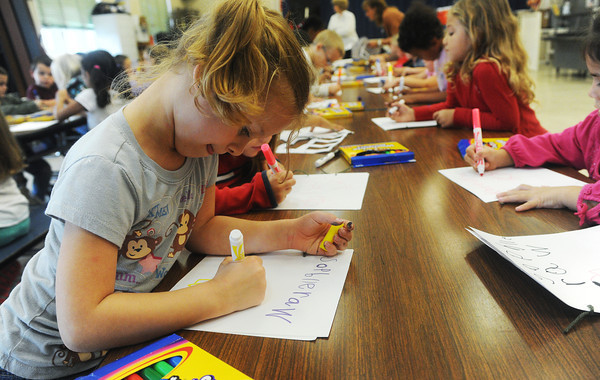 Globe/Roger Nomer<br /> Charlie Thurman, a kindergartner at West Central Elementary, works on a comic book in art class on Wednesday.