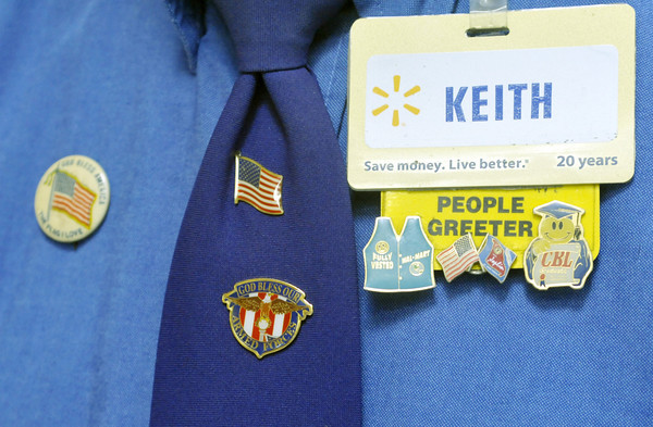 Globe/Roger Nomer<br /> Keith Fiscus works at Wal-Mart as a greeter and in the garden department.