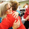 Bonnie Neal (left), chief of children's community operations with the Department of Mental Health in Kansas City, shares a warm embrace with Debi Meeds, regional CEO with the American Red Cross, during the Long-term Recovery Committee's final meeting Thursday afternoon, Oct. 24, 2013, at the Independent Living Center in Joplin.<br /> Globe | T. Rob Brown
