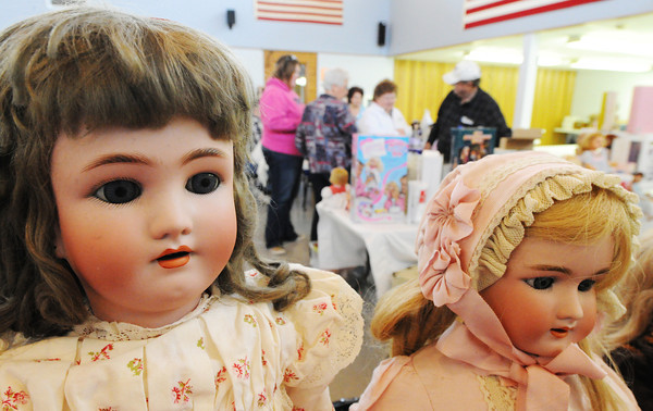 A pair of 1920s German biskue dolls owner by Joan Brooks of Joplin, a doll collector and dealer, are shown during the Doll Sale Saturday afternoon, Oct. 5, 2013, at the Joplin Senior Citizens Center. The event was organized by the Heartland Doll Club to pay for materials for them to build Healing Heart Dolls made as teaching tools for doctors and nurses.<br /> Globe | T. Rob Brown
