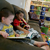 Globe/Roger Nomer<br /> Brothers Kevin, 2, left, and Ashton, 3, (last names withheld) read a book at Children's Haven on Monday morning.  The facility will soon move into its new building next door.