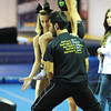 Madi Corsello (left), a Ventura, Calif., high school freshman, and Michaeleddie Rivera of Camarillo, Calif., lift up Jenee Cruise, a high school junior from Bakersfield, Calif., while demonstrating cheerleading technique for a group of cheerleading students Saturday afternoon, Oct. 19, 2013, in Pittsburg, Kan. She is wearing a new type of sports bra.<br /> Globe | T. Rob Brown