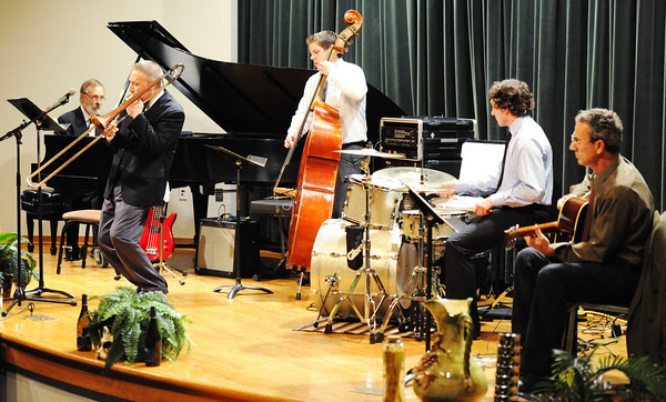 Dr. Phillip Wise (next to left) plays the trombone with the Joplin Jazz Collective as they perform in the style of Django Reinhardt, a famous Italian jazz guitarist, during the Wednesday evening, Oct. 2, 2013, musical event for MSSU's Italy semester at Webster Hall's Corely Auditorium.<br /> Globe | T. Rob Brown