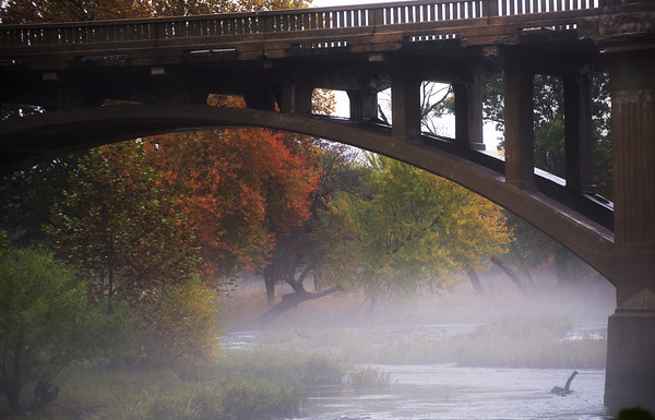 Globe/Roger Nomer<br /> On a foggy afternoon, fall colors begin to reveal themselves along the Redings Mill Bridge.