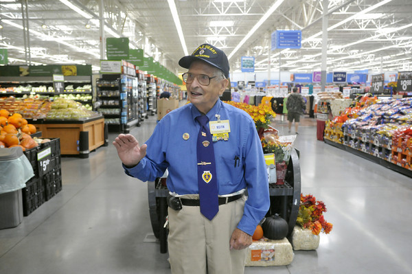 Globe/Roger Nomer<br /> Keith Fiscus greets shoppers at the 15th Street Wal-Mart on Wednesday morning.