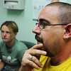 Patient James Fearmonti (right) and his wife Jessie Fearmonti, both of Frontenac, listen to nurse practitioner Todd Carl Wednesday morning, Oct. 9, 2013, at the Community Health Center of Southeast Kansas in Pittsburg.<br /> Globe | T. Rob Brown