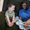 Globe/Roger Nomer<br /> Stephanie Theis, executive director at Children's Haven, reads a book with Kevin, 2, (last name withheld) at Children's Haven on Monday morning.  The facility will soon move into its new building next door.