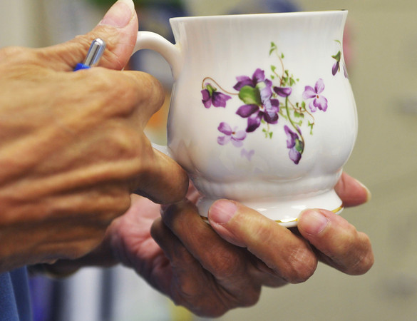 Globe/Roger Nomer<br /> Instead of a coffee mug, Head Nurse Doris Carson uses a china cup decorated with African Violets.  In her spare time, Carson is a judge of African Violets in gardening competitions.