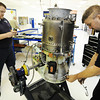 Mechanics Ian Matney (left) of Anderson and shop supervisor Danny Moore of Stark City, work together on repairing a 350-pound, 840 horsepower turbo prop engine, the Honeywell 331, Wednesday afternoon, Oct. 9, 2013, at CD Aviation in Joplin.<br /> Globe | T. Rob Brown