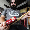 Dan McCain, owner of Wood & Wire Guitars, shows a homemade beverage can guitar Wednesday morning, Oct. 2, 2013, in his downtown Joplin business.<br /> Globe   T. Rob Brown