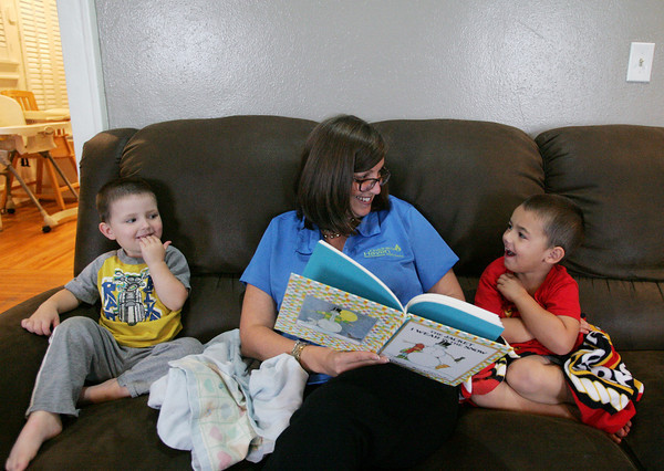 Globe/Roger Nomer<br /> Stephanie Theis, executive director at Children's Haven, reads a book with Kevin, 2, left, and Ashton, 3, (last name withheld) at Children's Haven on Monday morning.  The facility will soon move into its new building next door.
