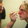 Globe/Roger Nomer<br /> David Glidden applies make up to Kaley Wheeler for a shift at The Gates of Hell on Tuesday.