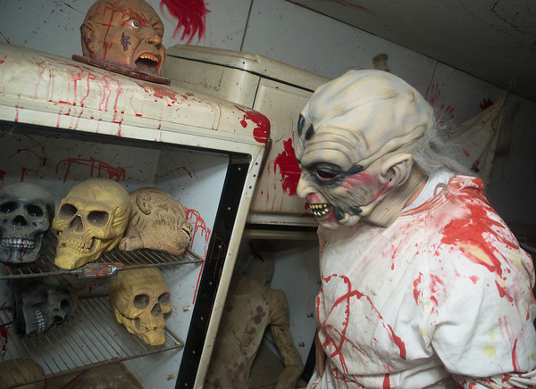 Globe/Roger Nomer<br /> Glen Hansen gets his props ready for a shift at the haunted house The Gates of Hell on Tuesday.