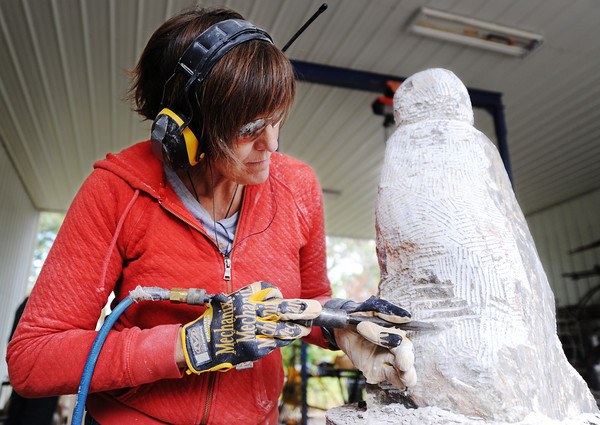 Stacy Deslatte, a Longview, Texas, artist, creates a sculpture of a person Wednesday afternoon, Oct. 16, 2013, at the Joplin home of Jorge Leyva.<br /> Globe | T. Rob Brown