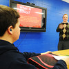 Instructor Patrick Bromley teaches a business class Wednesday, Oct. 16, 2013, at McAuley Catholic High School. Bromley was recently named Teacher of the Year from the diocese. Freshman Miles Shelfer listens at left.<br /> Globe | T. Rob Brown