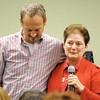 Debi Meeds, regional CEO with the American Red Cross, gives a tearful recount of events as she is comforted by Jay St. Clair, community outreach minister from College Heights Christian Church, during the Long-term Recovery Committee's final meeting Thursday afternoon, Oct. 24, 2013, at the Independent Living Center in Joplin.<br /> Globe | T. Rob Brown