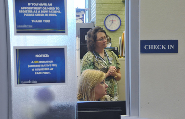 Globe/Roger Nomer<br /> Melinda Hoover, nurse practitioner at the clinic, top, and Sharla Chandler, office coordinator, show their concern for a patient who has missed their appointment at the clinic on Tuesday.