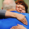 Connie Chrisman (right) hugs Ben Pawley, with the Presbyterian Disaster Assistance National Response Team, during the Long-term Recovery Committee's final meeting Thursday afternoon, Oct. 24, 2013, at the Independent Living Center in Joplin.<br /> Globe | T. Rob Brown