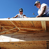 Carl Junction volunteers Richard Smith (right) and son Bryan Smith work on the roof of a new pavillion/shelter at Carl Junction's Memorial Park Thursday morning, Oct. 10, 2013.<br /> Globe | T. Rob Brown