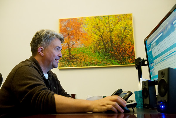 Globe/Roger Nomer<br /> Jon Koucky, president of NET-Vendor, Inc., works in his downtown office on Friday afternoon.