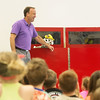 Globe/Roger Nomer<br /> Spot the dog gives a playful bite to Kevin Theilen, with The Alliance of Southwest Missouri, as they give a presentation on Thursday to students at Royal Heights Elementary. Joplin firefighters and The Alliance shared fire safety information with the students.