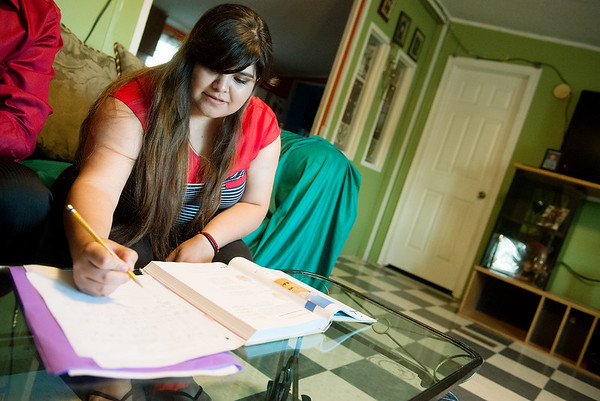 Globe/Roger Nomer<br /> Kassandra Medrano works on homework on Thursday evening at her home in Monett.