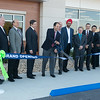 Globe/Roger Nomer<br /> Gordon Walker, president of EaglePicher Technologies, cuts the ribbon on Friday at the company's new facility.