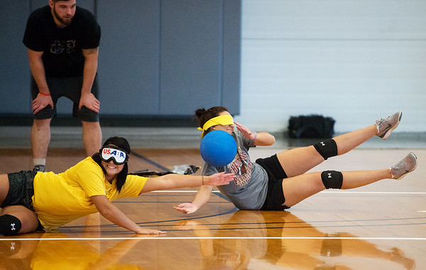 Globe/Roger Nomer<br /> Chelsea Montgomery, a Pittsburg State senior from Pittsburg, left, and Alex Andrews, a senior from Weir, Kan., try to block a ball during a demonstration of Goalball on Tuesday at the PSU Student Rec Center.