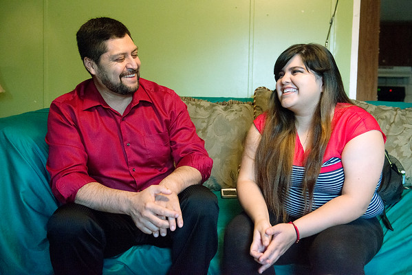 Globe/Roger Nomer<br /> Kassandra Medrano talks with her father Benito on Thursday at their home in Monett.