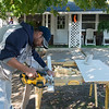 Globe/Roger Nomer<br /> Tim Henderson, with Economic Security, works on weatherizing a house on Thursday in Duenweg.