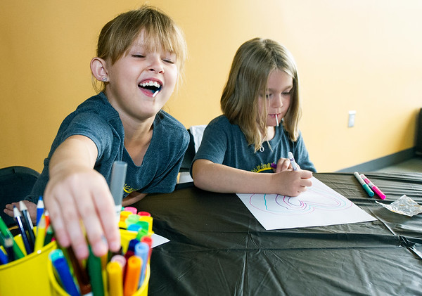 From the left: Larissa Pointer, 7 and Kyree Choate, 6, explore their creative sides during the Victory Art Camp on Saturday at Victory Ministry and Sports Complex.<br /> Globe | Laurie Sisk