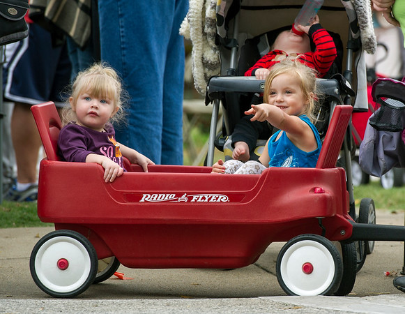 From the left: McKenzie Root, 2 and Jaiden Millard, 3, both of Carthage, enjoy the sights and sounds of the 50th Annual Maple Leaf Parade from the comfort of their wagon on Saturday in Carthage.<br /> Globe | Laurie Sisk