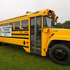 A school bus parked outside Neosho High School on Wednesday advertises a need for drivers.<br /> Globe | Laurie Sisk