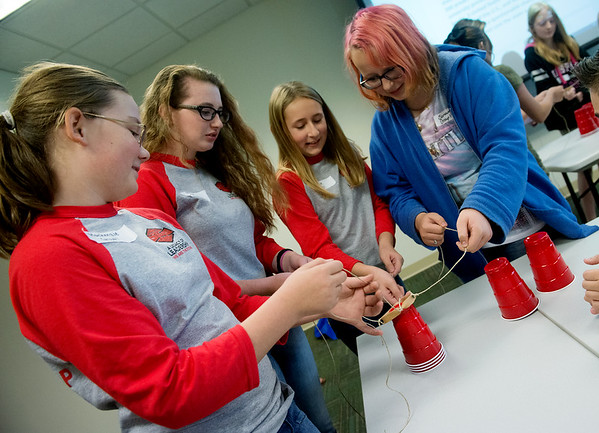 Globe/Roger Nomer<br /> (from left) MacKenzie Suter, Fordland Middle School sixth grader, Alissa Lucas, eighth grader, Audrie Buckert, sixth grader, and Samantha Ellis, Cassville Middle School seventh grader, work on a leadership activity on Wednesday at Billingsly Student Center during the Middle-Level Leadership Day.