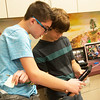Globe/Roger Nomer<br /> Zachary Cook, left, and Benjamin Koelkebeck, eighth graders, work with technology on Tuesday at South Middle School.